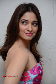 Actress Tamanna Latest Images in Floral Short Dress at Okkadochadu Movie Promotions  0120.JPG