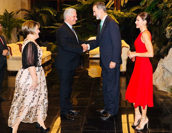The Queen wore a red Carolina Herrera dress. Jimmy Choo metallic leather gold sandals, Carolina Herrera clutch