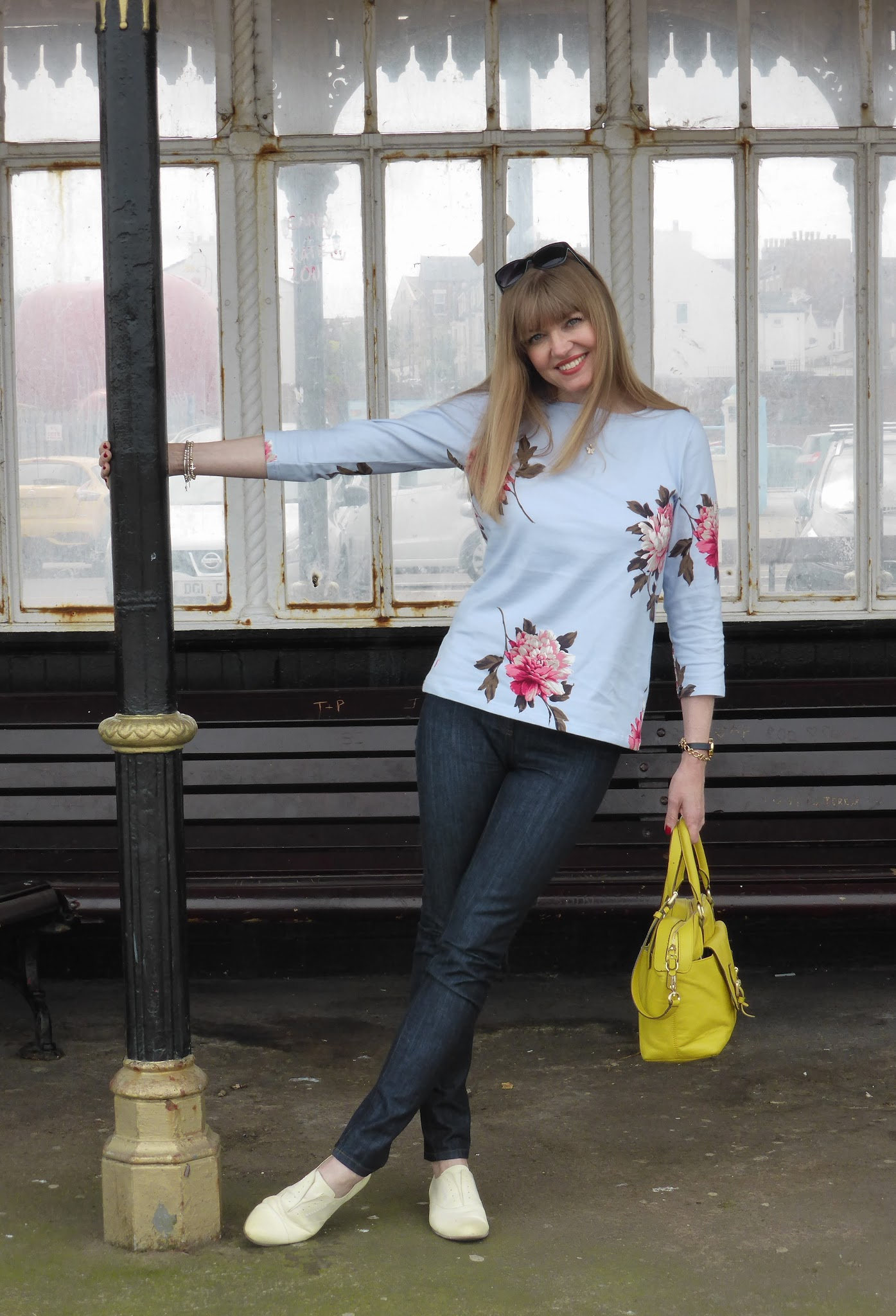 What Lizzy Loves, over 40 blogger wearing Joules blue and pink floral Harbour top, Boden skinny jeans, Boden yellow bowling bag, Clarks pale yellow leather brogues