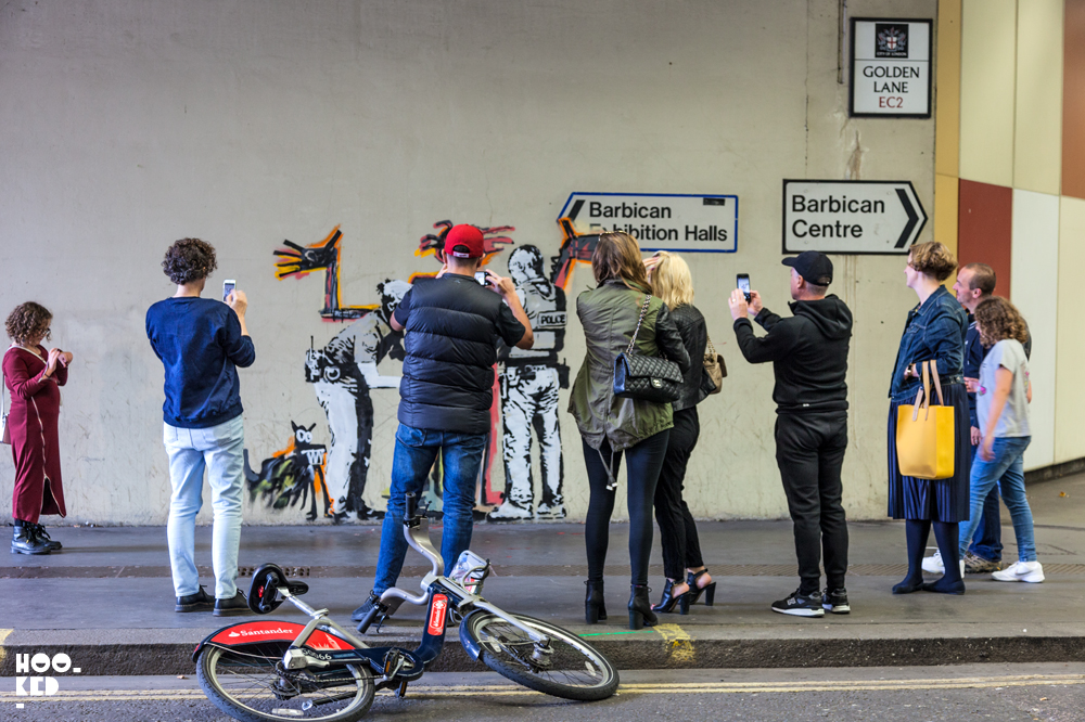 Street art stencil works appear in London at the Barbican by artist Banksy