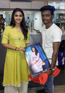 Keerthy Suresh in Green Dress with Cute Smile with a Fan