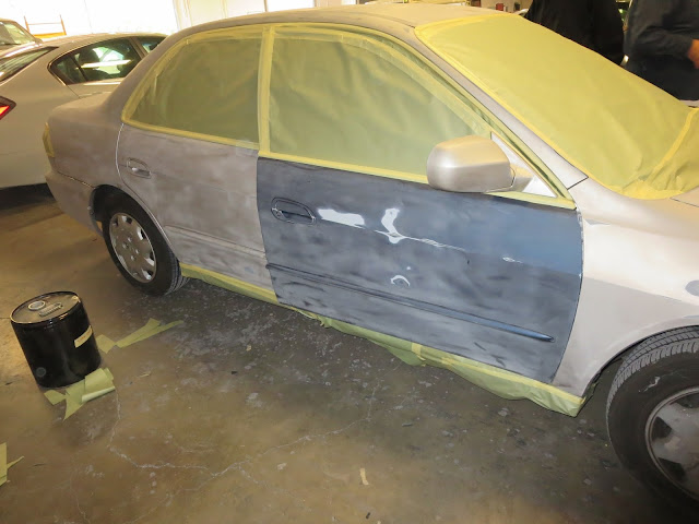 Honda being masked for paint at Almost Everything Auto Body