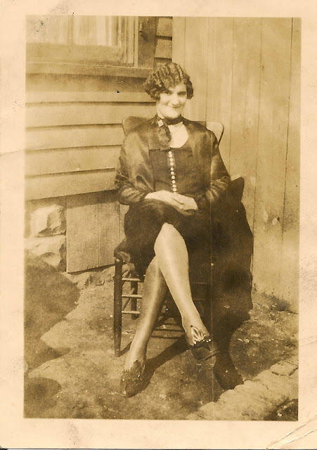 Unidentified woman with a Marcel Wave and some very fine shoes. Possible connection to Dixon or Karvoius families, Elizabeth, N.J.