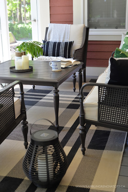 RamblingRenovators.ca | porch decor | outdoor caned wingback chair, plaid outdoor rug, palm leaves, cottage tropical decor