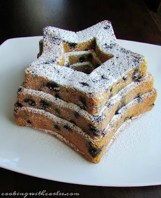side view of star shaped blueberry bundt cake