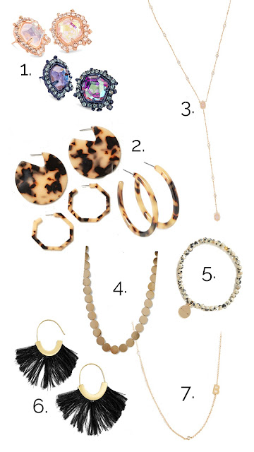 jewelry laid out from south moon under, baublebar and kendra scott for holiday gift guide inspiration