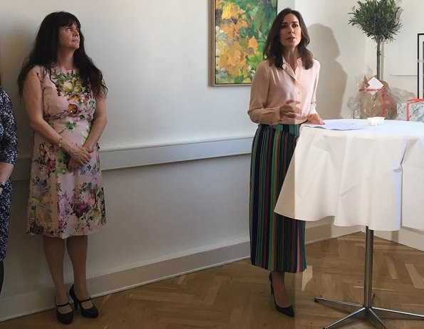 Crown Princess Mary wore Diane Von Furstenberg Tailored Asymmetric Overlay Skirt. The Danish Women's Society and The Mary Foundation.