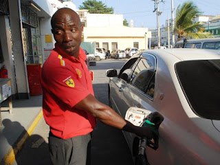 A Pump attendant fueling a car in Mombasa. PHOTO | courtesy