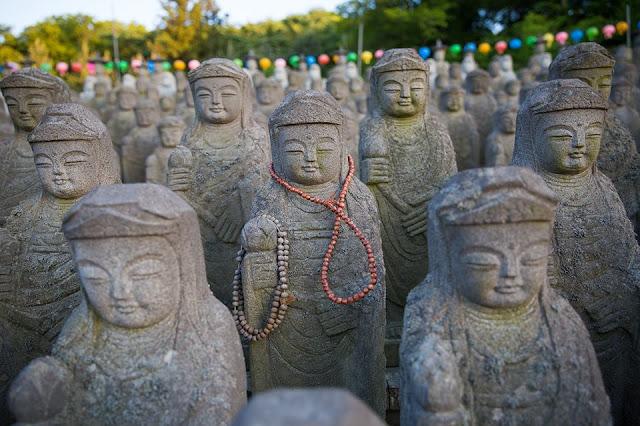 Budda Statues by Douglas Macdonald
