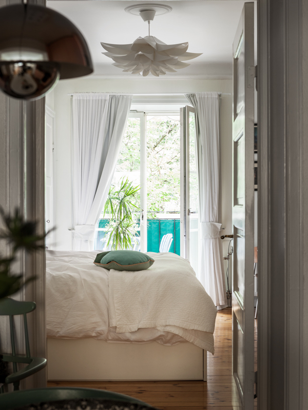 All white bedroom with plants- design addict mom
