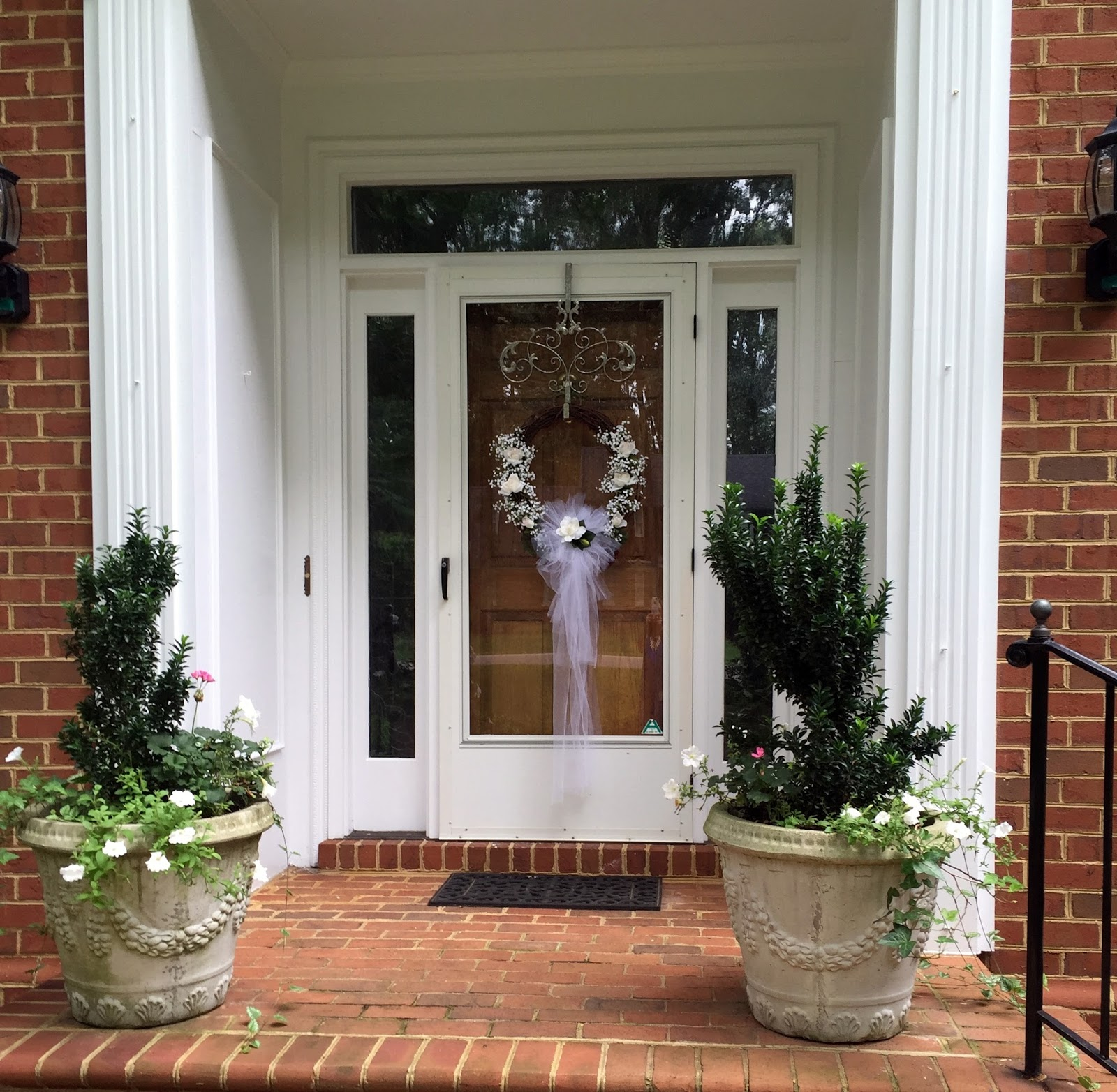A Bridal Wreath Adorned The Front Door I Used Pew Bow Which Had Made For Wedding Of Friend In Center Along With Roses And Baby S Breath