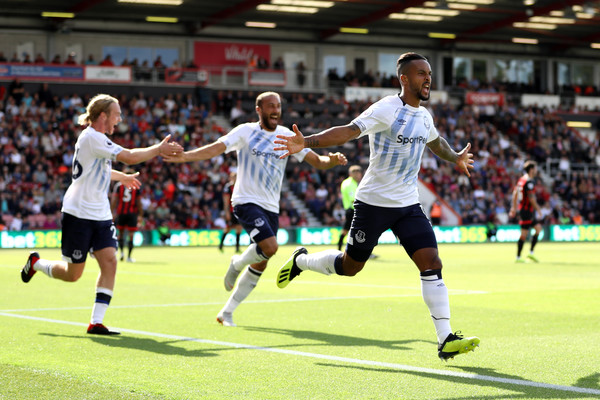 Theo Walcott of Everton celebrates with team mates after scoring his team's first goal during the Premier League match between AFC Bournemouth and Everton FC at Vitality Stadium on August 25, 2018 in Bournemouth, United Kingdom.