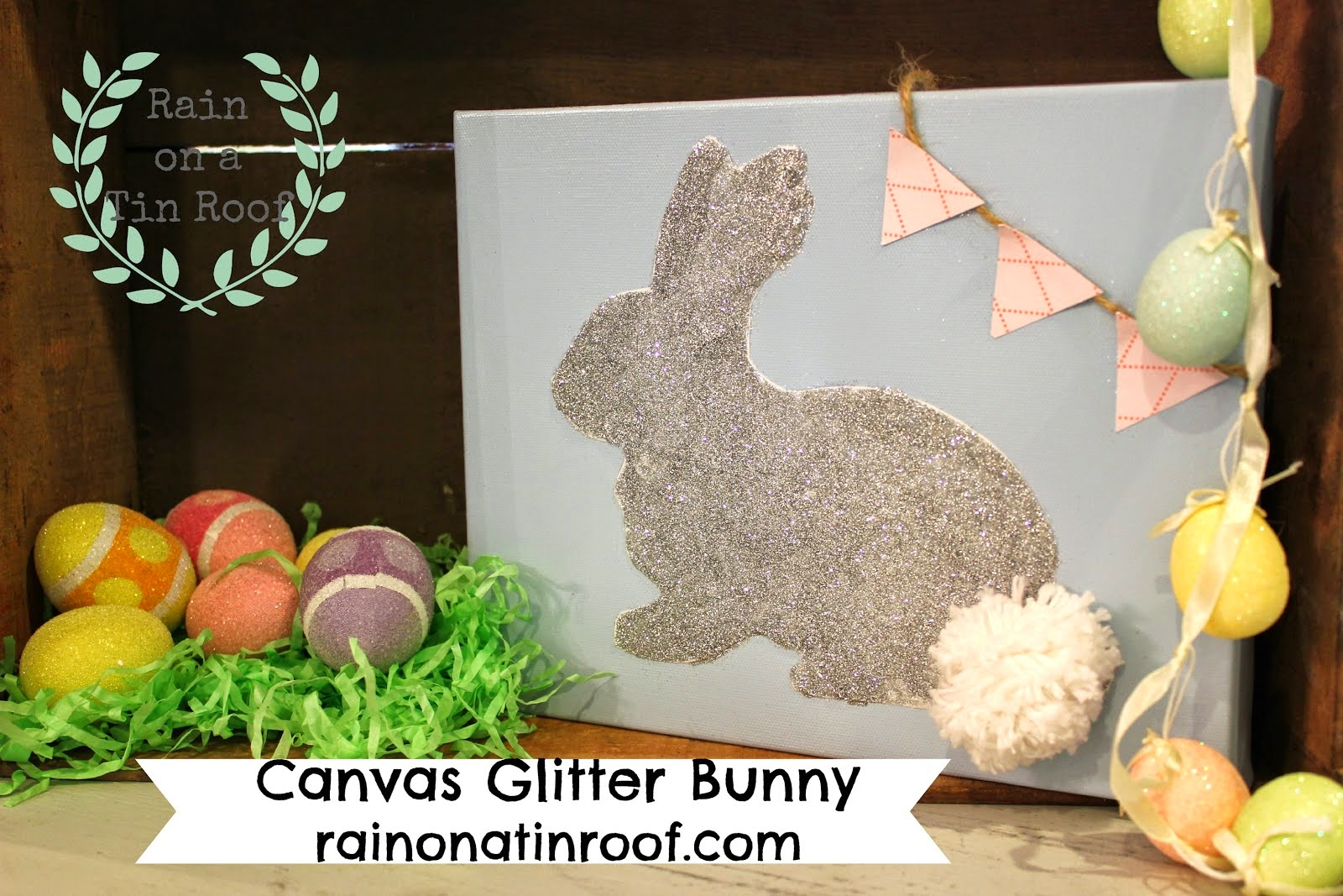 A glitter bunny with a wool cotton tail.