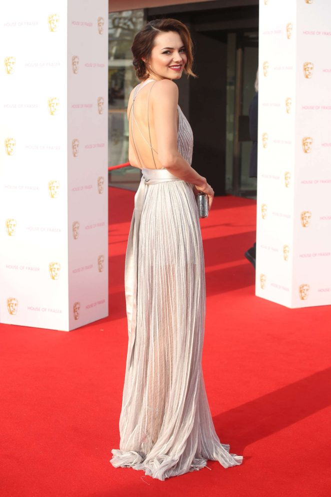 Kara Torin wears a plunging gown with sheer skirt to the BAFTA TV Awards 2016