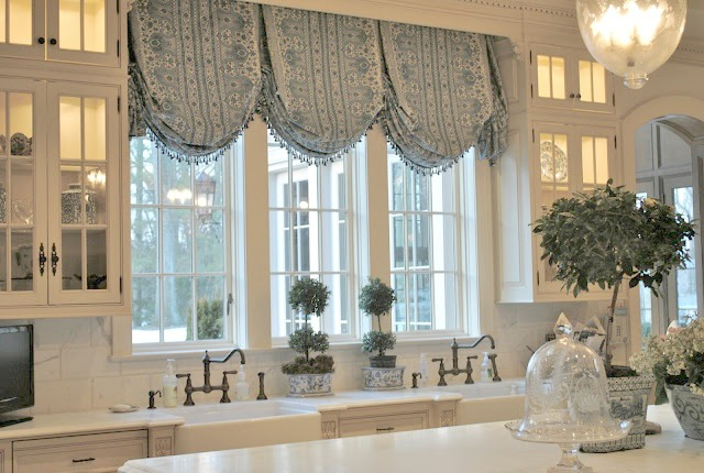 Blue and white Enchanted Home French inspired kitchen with farm sink and balloon valance