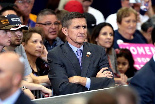 Image Attribute: The file photo of Michael Flynn at a campaign rally for Donald Trump in Phoenix, Arizona. Flickr/Creative Commons/Gage Skidmore