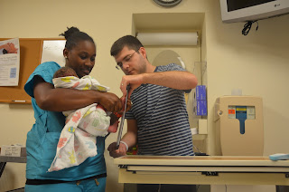 Nurse and father getting baby's footprint