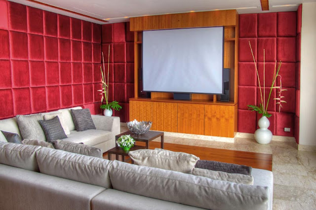 Home theater room with red satin walls
