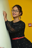 Aditi Myakal in Spicy Red Short Skirt and Transparent Black Top at at Big FM For Promotion of Movie Ami Tumi 029.JPG