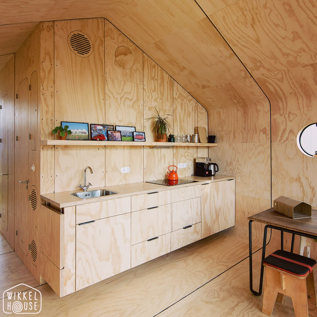 02-Kitchen-and Dining-Area-Fiction-Factory-Wikkel-House-Cardboard-Architecture-www-designstack-co