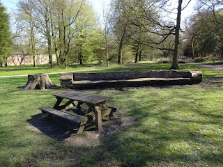 Two quite different benches at Haigh Woodland Park in Wigan