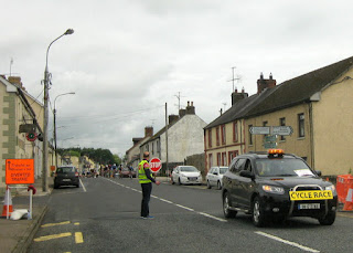Car leading cyclists in the Emyvale Grand Prix, Emyvale, Ireland