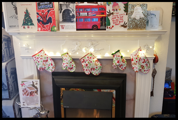 Adding mittens round the fireplace for Christmas