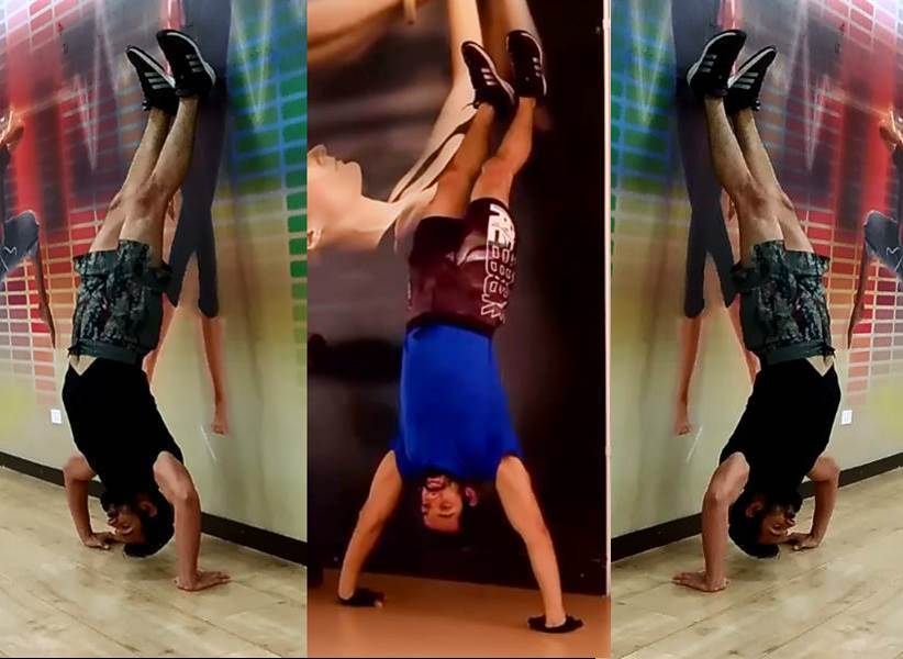 Flexiones de brazo parado de manos - Hand stand push ups