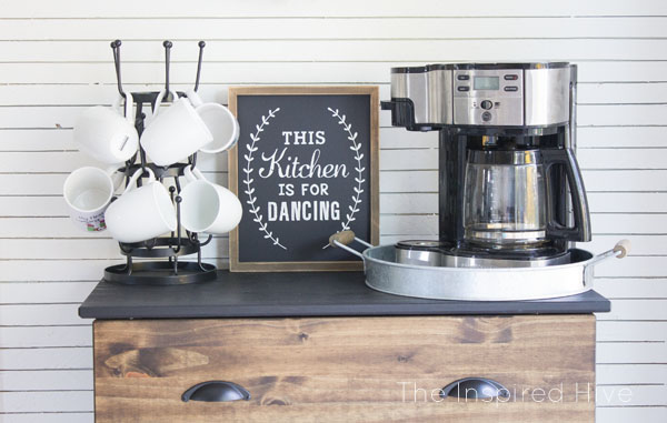 Gorgeous farmhouse kitchen makeover. I love the skinnylap wall and the rustic coffee bar!