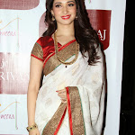 Tamanna hot pictures in white saree for jewellery ads