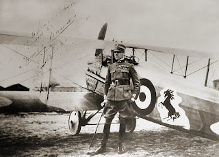 Francesco Baracca alongside his Spad XIII with the  family's prancing stallion logo displayed on the side