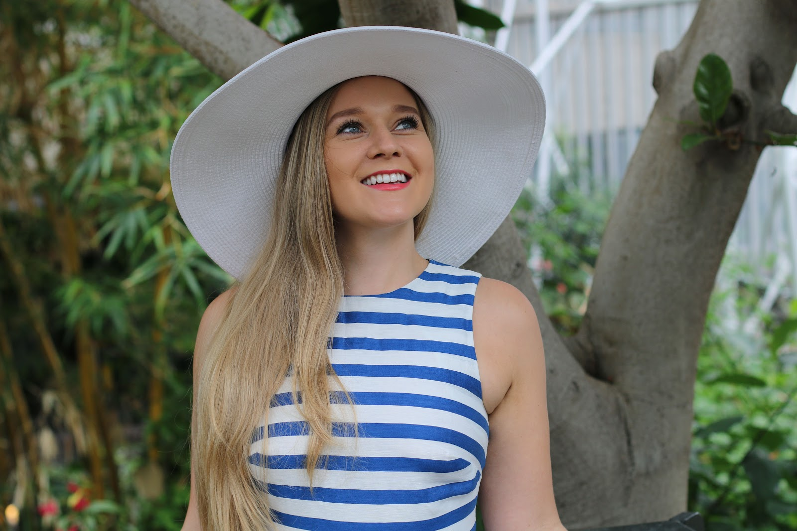 Blonde Girl, Katie Heath, wearing white Pia Rossini Hat, and Blue and White Striped L.K.Bennett Dress, Photographed by Lydia Collins