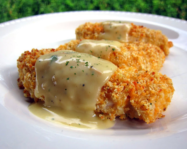 Crispy Cheddar Chicken Tenders Recipe - chicken tenders coated in cheddar, Ranch and Ritz Crackers then baked and topped with a delicious sauce. One of our all-time favorite chicken recipes. Can coat the chicken ahead of time and freeze unbaked for later. Make sauce while tenders bake. Quick and easy weeknight meal!