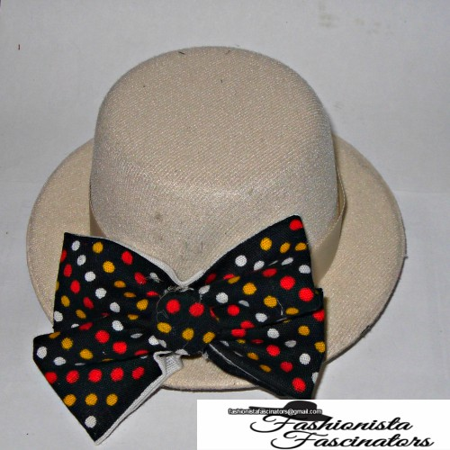 Cream Fascinator Hat With A Black Bow Tie Red Yellow And White Polka Dots