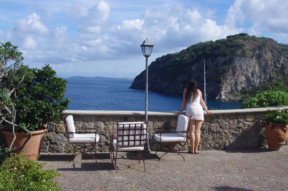 Girl overlooking sea from Mezzatorre Resort & Spa Ischia