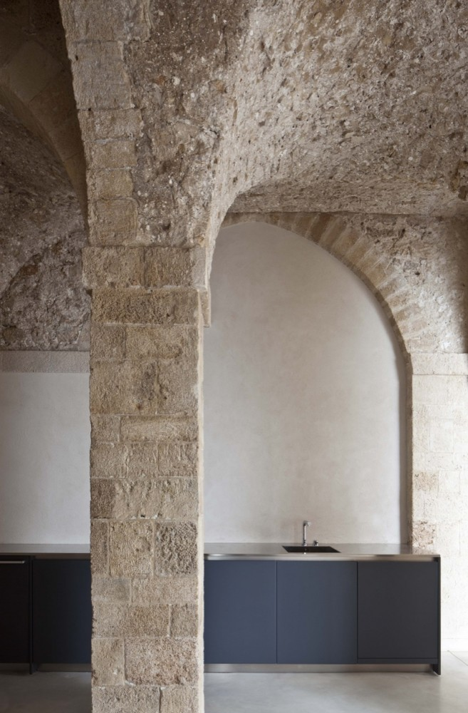While the textures of the exterior of the house were preserved as was much of the interior the aim was to make the apartment appear more urban and