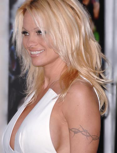 b8c61211455d9 Often seen as armbands, this form of tattoo wildly popularized by Pamela  Anderson when she starred in Barb Wire.