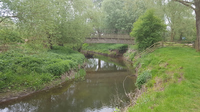 A bridge across the River Ouzel at Ouzel Valley Park, Milton Keynes