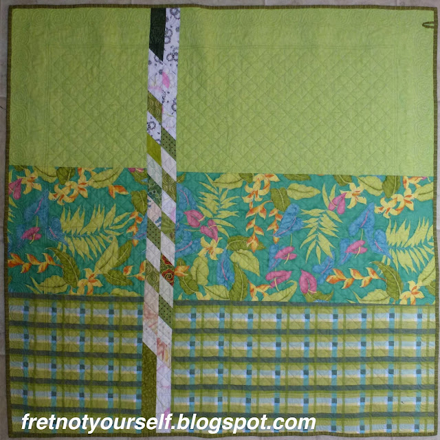Quilt back with insert of leftover blocks