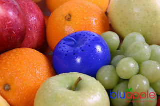bluapple produce saver with oranges and fruit