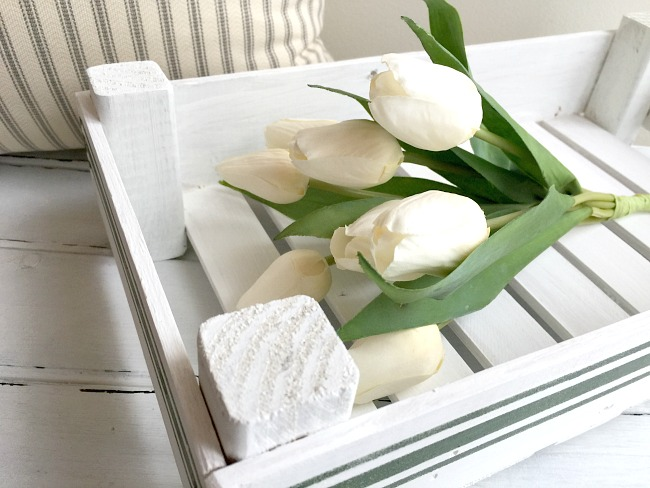 Tulips in a white wooden crate