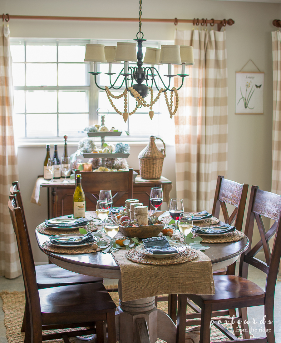 Simple Thanksgiving tablescape with wine in glasses