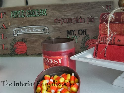 Harvest tin filled with candy corn.