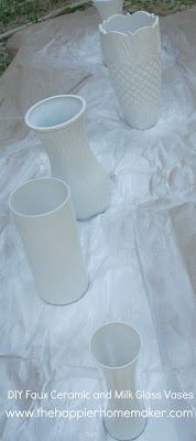 Several vases that are were painted white