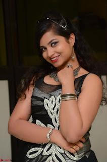 Shrisha Dasari in Sleeveless Short Black Dress At Follow Follow U Audio Launch 068.JPG