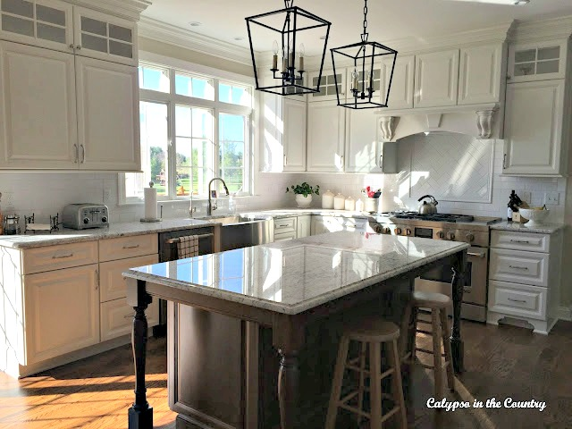 white kitchen wood island