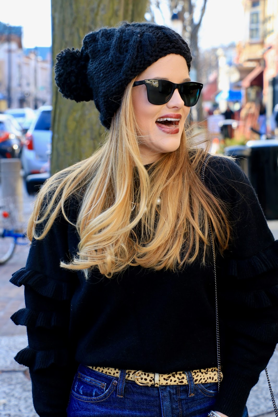 Nyc fashion blogger Kathleen Harper wearing a black pom beanie