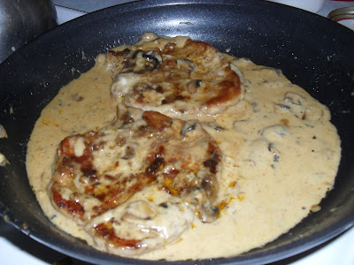 Pork Chops Simmering in a Low-Carb Mushroom Gravy