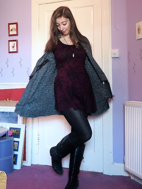 Bundled Up - outfit of short, purple and black floral print dress, chunky grey cardigan, woollen tights, and tall black riding boots