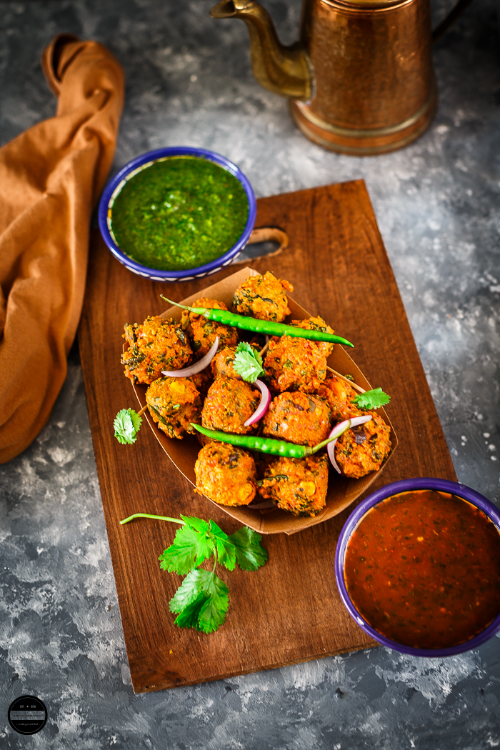 These irresistible Methi Corn Bhajiyas made in a combination of Fresh Fenugreek leaves, tender corn, coarse gram flour and aromatic dried spices and then deep fried till lovely golden brown.
